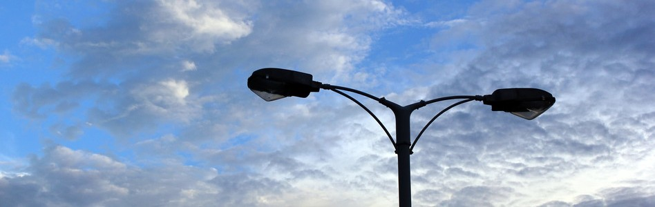 Silhouette of street light on beautiful sky background